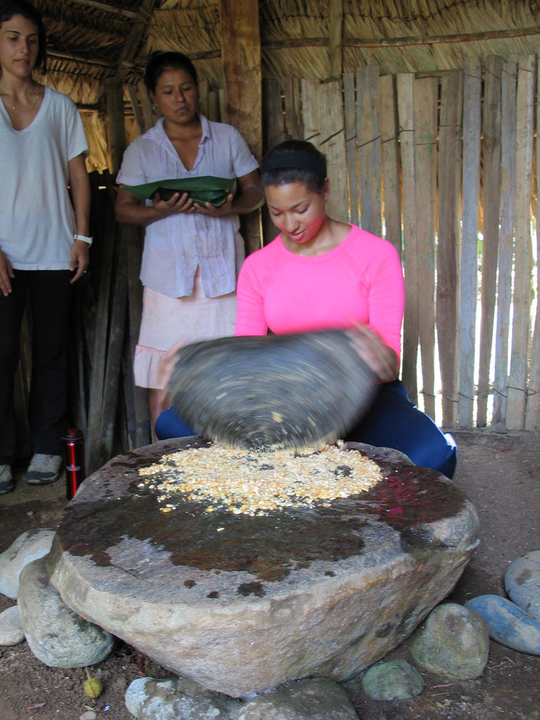 UGA student Jalyn DeCausey grinds corn in the traditional way. The Bribri people often grind corn to make a traditional fermented beverage called chicha.